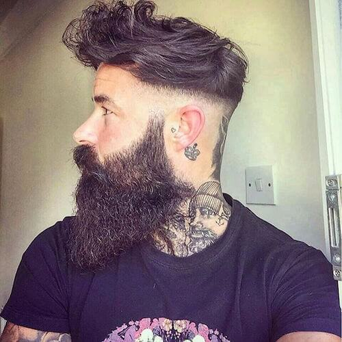 Low Bald Fade Curly Quiff With A Disconnected Beard